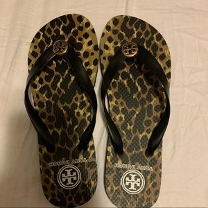 Tory Burch leopard flip flops. Never worn.